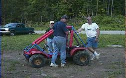 Redrider (left) & Hoser  (right) trying to help Chris get his Oddy running again